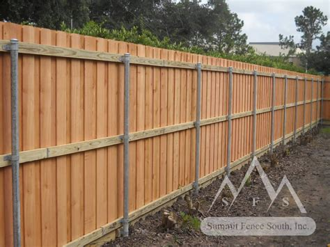 home fences and gates custom wood fence with steel posts summit fence south