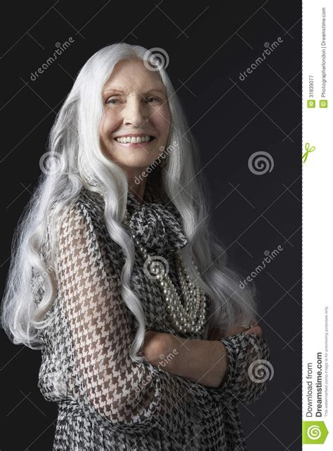 Senior Woman With Arms Crossed Smiling Stock Image Image