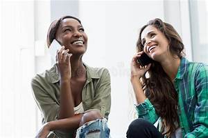 Friends Talking On Mobile Phone Stock Photo - Image of ...