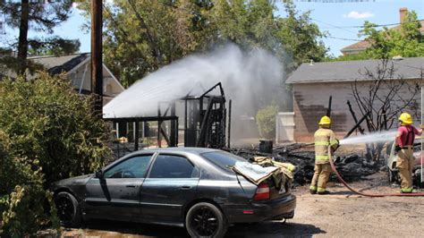 firefighters battle backyard blaze consuming sheds st george news
