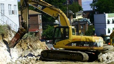 cat  excavator  hammer youtube