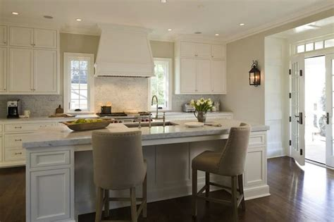 kitchen central island elegant light filled kitchen with custom cabinetry and central island with bar seating french