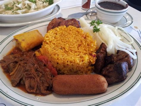 ac versailles cuisine the criollo rice beans ropa vieja fried pork chunks