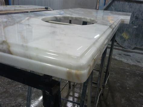 Project Spotlight Calcutta Gold Marble Bathroom  Granite