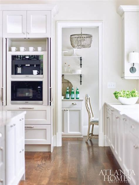 hidden coffee maker  microwave  pantry cabinets
