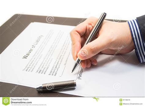 signing  waiver  liability form stock photo image