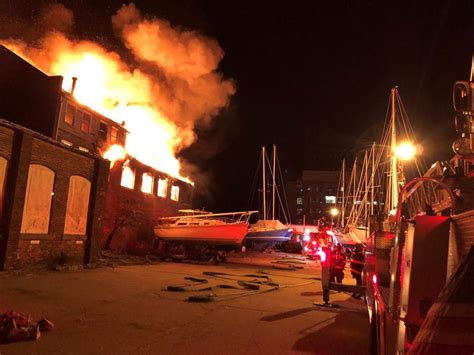 A woman cries as she. Crews battle 2nd alarm fire at Fort Trumbull Marina in New ...