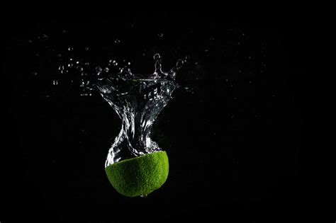 Black Stock Images Lime In Water With Black Background Free Stock Photo
