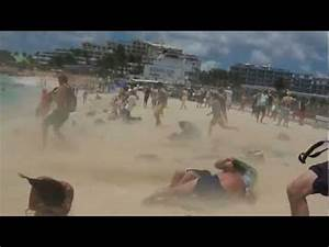 girl blown over by jet blast at Maho Beach - YouTube