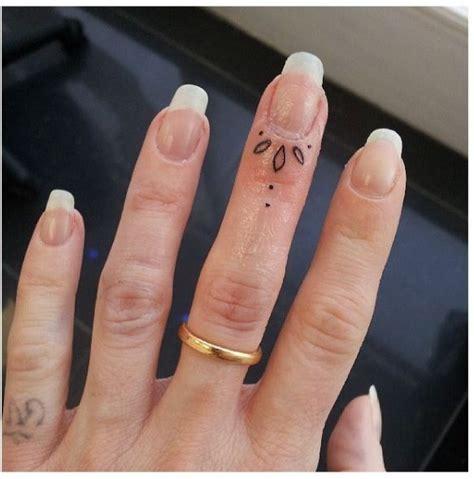 fingernail flower design  adorable tiny finger tattoos