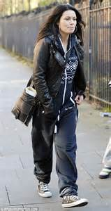 converse designs at corrie 39 s alison king clings on to youth as she arrives at work in a onepiece