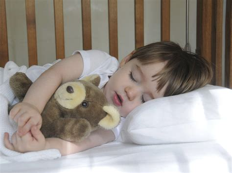 when should baby start sleeping in crib how and when should i move my child from a crib to a bed