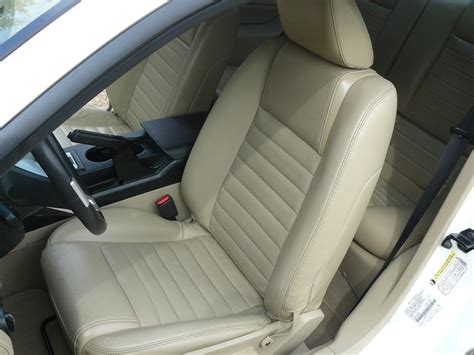 replaced cloth seat covers  leather  mustang