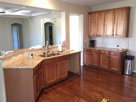 painting kitchen cabinets    painter paints kitchen cabinets