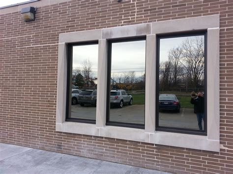 commercial painted windows picture  awning bronze