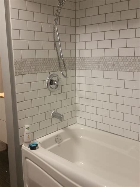 Tiling A Tub Shower by White Subway Tile Bathtub Surround With Marble Hex Tile