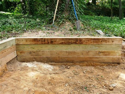 how to build a wood retaining wall building a timber retaining wall how tos diy