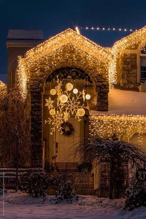 christmas decorating  lighted snowflakes outdoor