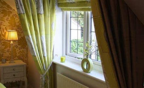 dormer window  show curtains  matching roman blind