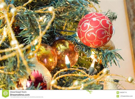 new year baubles on decorated christmas tree with blurred