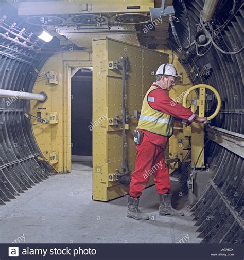 channel tunnel engineer operating cross passage steel door