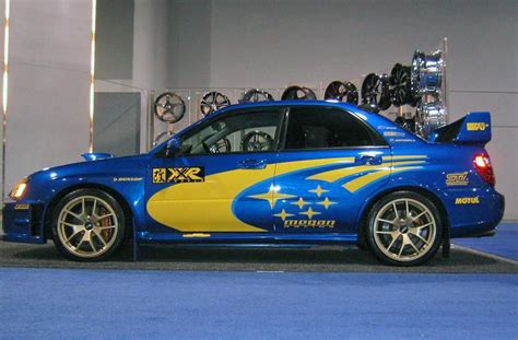 blue subaru gold rims primax wheel 2005 subaru wrx sti to be on display at