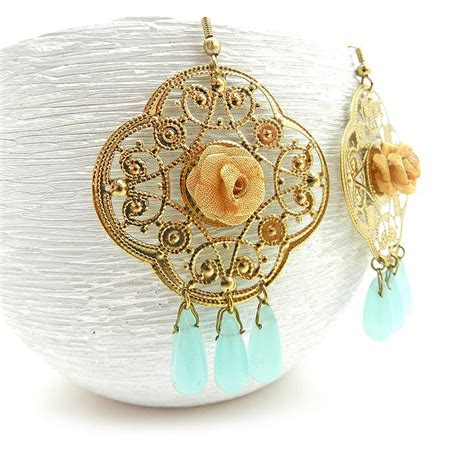 large gold chandelier earrings with pale blue drops on luulla