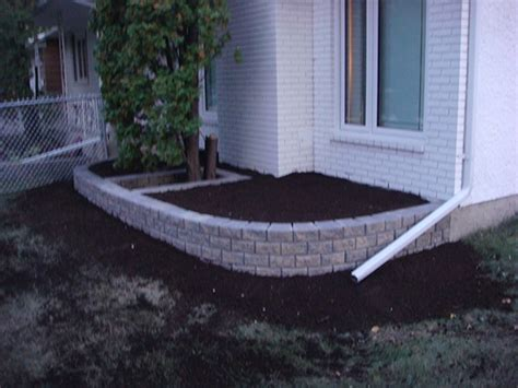 stack stone retaining wall planter  front  house