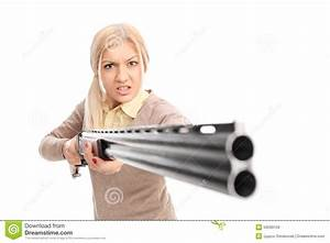 Angry Girl Pointing A Rifle At The Camera Stock Photo ...