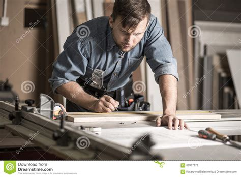 woodworker working  professional workbench stock image
