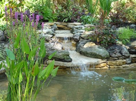 backyard ponds and waterfalls garden ponds and waterfalls pond design with stilted deck area and planting herbs and