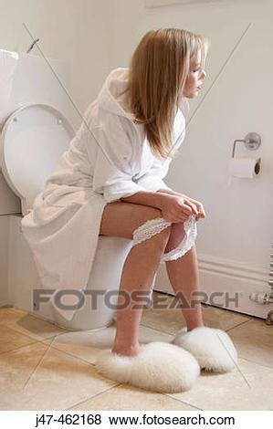 pictures of sitting on the toilet with ankles j47 462168 search stock