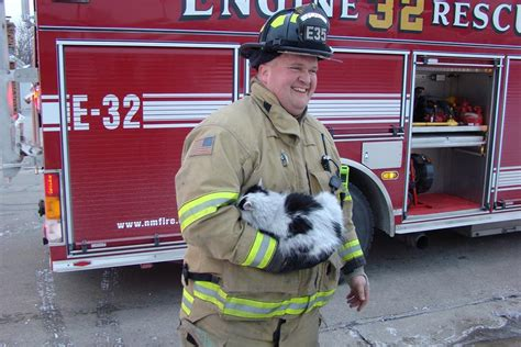 Firefighter Rescues And Revives Cat At House Fire