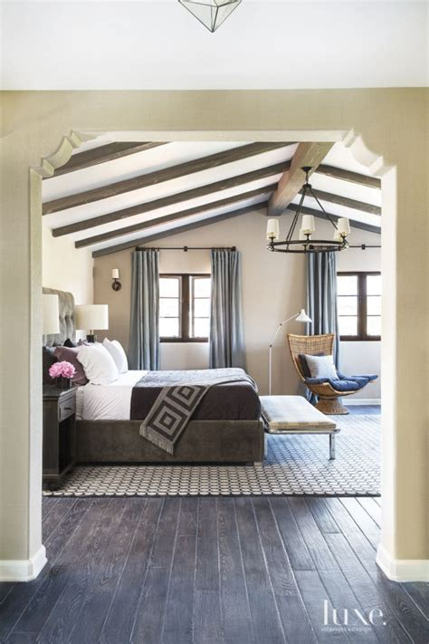 spanish colonial neutral bedroom  vintage bench