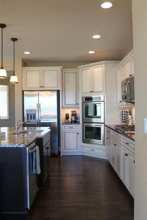 white kitchen cabinets  hardwood floors
