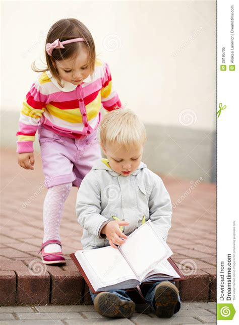 Boy And Girl Reading Book Royalty Free Stock Photo  Image 28195705