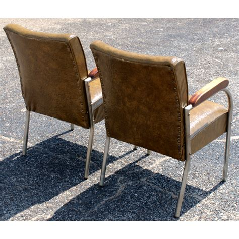 2 mid century chrome and vinyl arm chairs