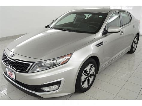 Pre Owned Kia Optima by Pre Owned 2013 Kia Optima Hybrid Lx 4dr Car In