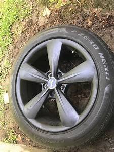Four Ford Mustang rims with tires (235/50/18) (FSU/Tallahassee) - Sell My Tires