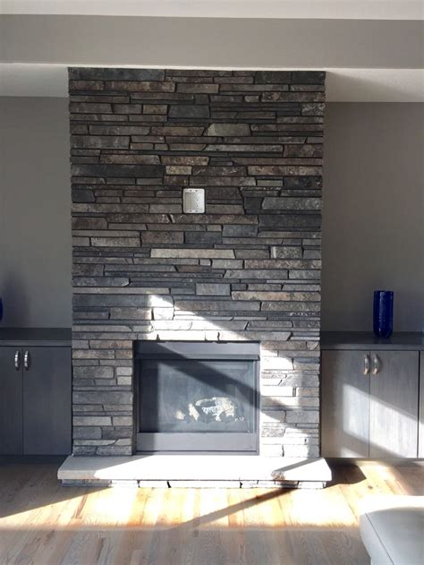 gray  brown dry stacked stone fireplace   stone