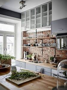 30 trendy brick accent wall ideas for every room digsdigs for Kitchen cabinet trends 2018 combined with wall clock art deco