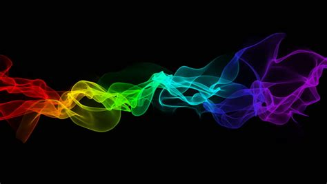 rainbow color smoke flowing black background