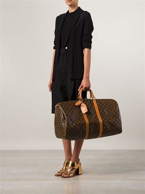 louis vuitton keepall  travel bag  brown lyst