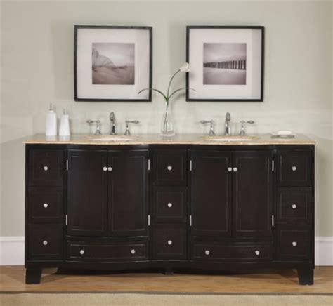 dark brown double sink vanity  travertine counter top uvsr
