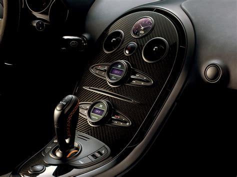 Fake rims, fake headlights, fake engine cover. Adam's Amazing Book: Bugatti Veyron Super Sport