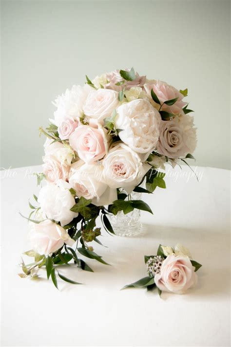 A Blush Tear Drop Bouquet Of Peonies And Roses Pretty And