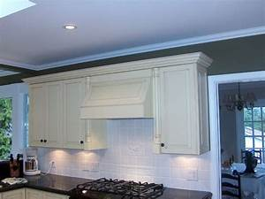 Antiqued White Cabinets & Range Hood - Traditional