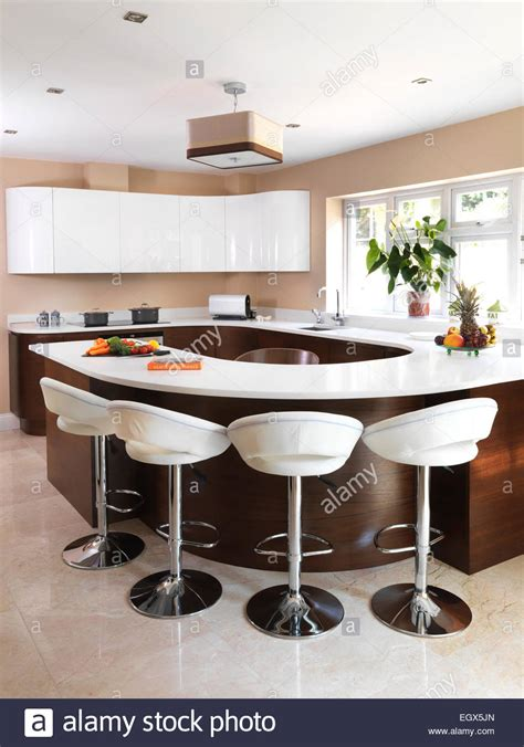 kitchen island with breakfast bar and stools bar stools at breakfast bar in modern kitchen uk home 9804