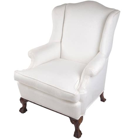 wingback chair on claw and foot mahogany frame for