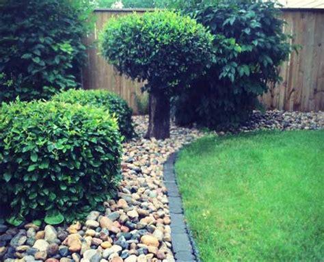 shrub rock bed signature landscaping regina sk